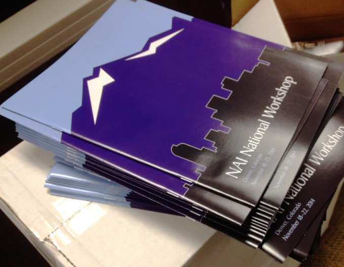 A stack of NAI Workbooks